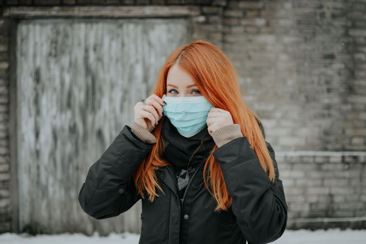 Redhead girl with a mask during the 2020 coronavirus outbreak. Photo courtesy of Pille Riin Priske.